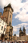 The tower of the Old Town Hall and the twin towers of the Tyn Church stretch above Old Town Square, Prague, Czech Republic