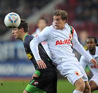 FUSSBALL   1. BUNDESLIGA  SAISON 2011/2012   16. Spieltag FC Augsburg - Borussia Moenchengladbach            10.12.2011 Patrick Herrmann (li, Borussia Moenchengladbach) gegen Marcel de Jong (FC Augsburg)