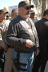 This protester armed with Ruger Semi Auto Pistol Claims that he is armed to defend himself while Protesting at State Capitol in Phoenix, AZ Tuesday, February 22, 2011..Photo by AJ Alexander