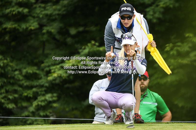 Pernilla Lindberg (front) and her caddie (back) review the 7th green at the LPGA Championship 2014 Sponsored By Wegmans at Monroe Golf Club in Pittsford, New York on August 16, 2014