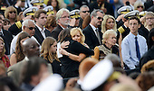 People get emotional at a memorial for the victims of the Washington Navy Yard shooting at the Marine Barracks, September 22, 2013 in Washington, D.C.  United States President Barack Obama and first lady Michelle Obama also visited with families of the victims. <br /> Credit: Olivier Douliery / Pool via CNP