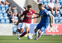 Shaun McWilliams of Northampton Town cuts inside Ben Stevenson of Colchester United during Colchester United vs Northampton Town, Sky Bet EFL League 2 Football at the JobServe Community Stadium on 24th August 2019