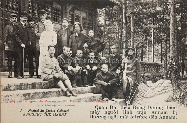 Wounded Annamite (Vietnamese) soldiers injured in the Battle of Annam, visited by Officer Dai Bieu from the government of Indochina, outside the hospital used during the First World War for treating colonial troops, originally the Cochinchina Pavilion (Cochinchina, now in South Vietnam, was a French colony 1862-1954) in the Jardin d'Agronomie Tropicale, or Garden of Tropical Agronomy, in the Bois de Vincennes in the 12th arrondissement of Paris, postcard from the nearby Musee de Nogent sur Marne, France. During the war the colonial hospital treated over 4800 patients and it closed on 1st May 1919. The garden was first established in 1899 to conduct agronomical experiments on plants of French colonies. In 1907 it was the site of the Colonial Exhibition and many pavilions were built or relocated here. The site is listed as a historic monument. Picture by Manuel Cohen / Musee de Nogent sur Marne