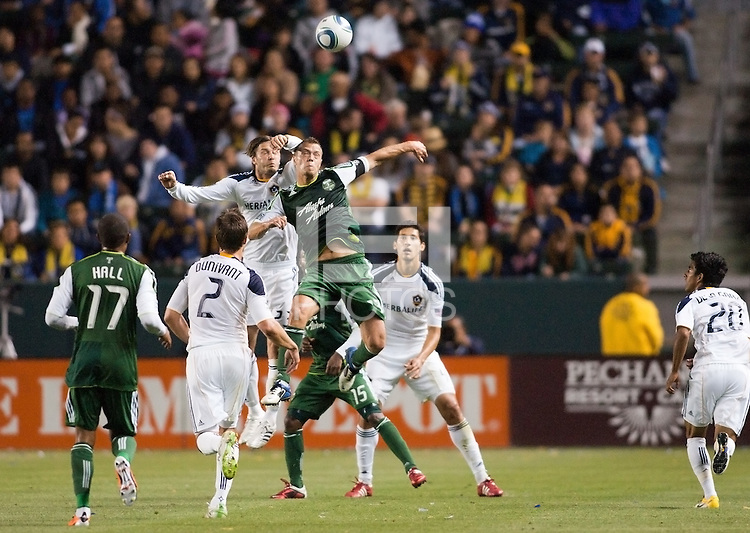 David Beckham (23) battles Jack Jewsbury (13) of the Portland Timbers for position on a head ball. The LA Galaxy defeated the Portland Timbers 3-0 at Home Depot Center stadium in Carson, California on  April  23, 2011....