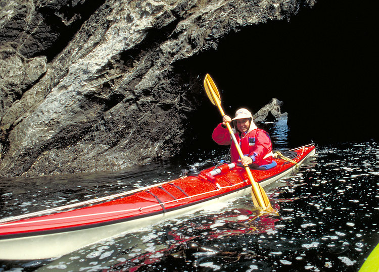 Exploring sea caves by kayak on Mendocino Bay