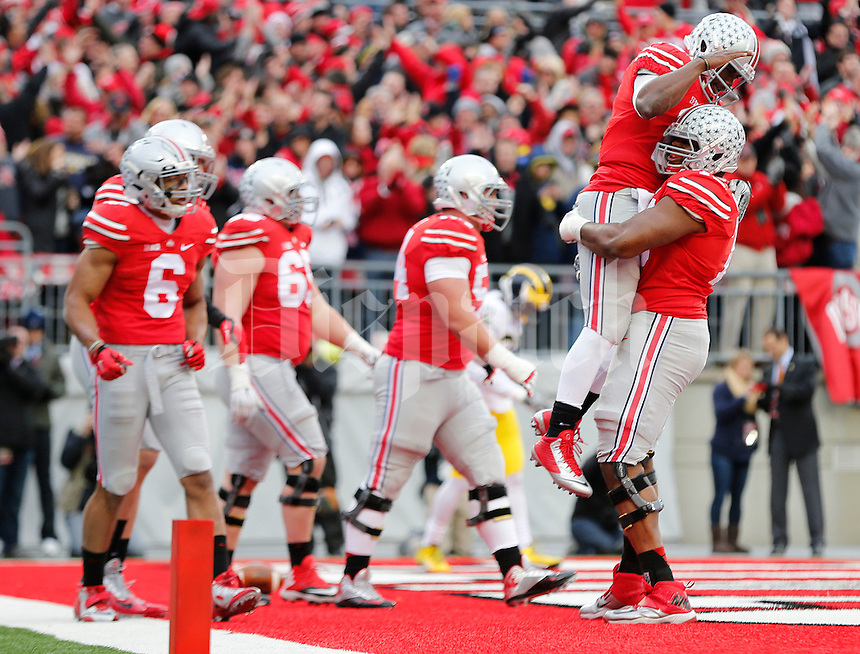 Ohio State Buckeyes quarterback J.T. Barrett (16) celebrates his touchdown with Ohio State Buckeyes offensive lineman Darryl Baldwin (76) during the college football game between the Ohio State Buckeyes and the Michigan Wolverines at Ohio Stadium in Columbus, Saturday morning, November 29, 2014. The Ohio State Buckeyes defeated the Michigan Wolverines 42 - 28. (The Columbus Dispatch / Eamon Queeney)
