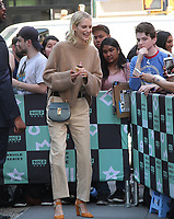 NEW YORK, NY - MAY 3: Birthday girl Poppy Delevingne spotted holding a cupcake with a candle atop as she leaves Build Series in New York, New York on May 3, 2018.  Photo Credit: Rainmaker Photo/MediaPunch