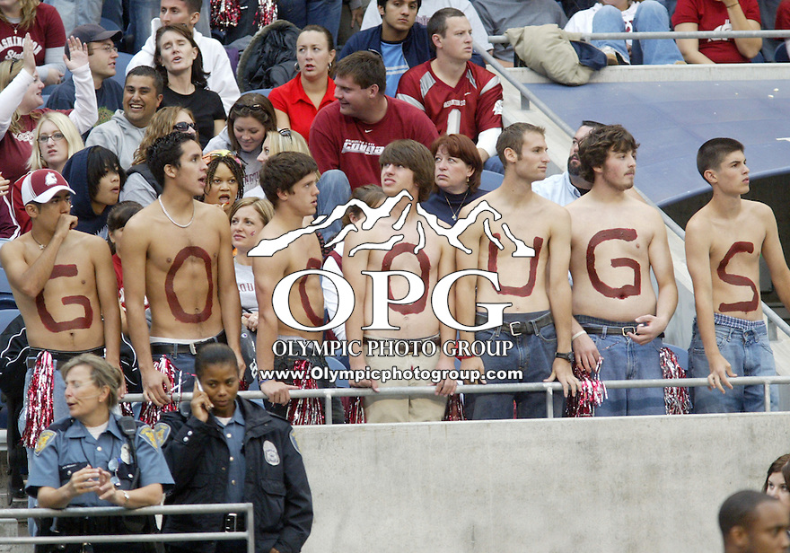 September 17, 2005:   Washington State University fans showed their skin while also showing team spirit. Washington State University won 48-7 over Washington State University  at Quest Field in Seattle, WA.
