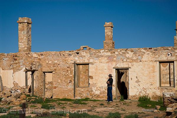 Tourist among ruins of Farina, outback South Australia