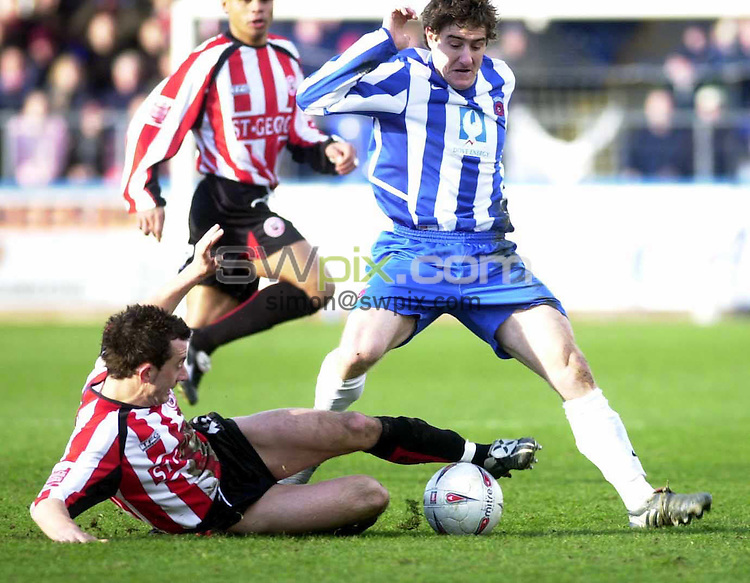 Pics: Chris Whiteoak/SWpix: Football, FA Cup 4th Round replay, Hartlepool v Brentford. 12/2/05..Hartlepool's Joel Porter is tackled by Brentford's Stephen Hunt