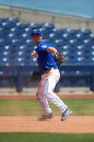 Tulsa Drillers third baseman Jarek Cunningham (37) throws to first during a game against the Midland RockHounds on June 3, 2015 at Oneok Field in Tulsa, Oklahoma.  Midland defeated Tulsa 5-3.  (Mike Janes/Four Seam Images)
