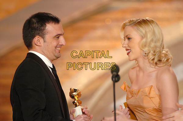 SCARLETT JOHANSSON.62nd Annual Golden Globe Awards, Beverly Hills, Los Angeles, California.January 16th, 2005.headshot, portrait, stage, microphone, strapless peach, orange, profile, award, trophy.www.capitalpictures.com.sales@capitalpictures.com.Supplied by Capital Pictures.
