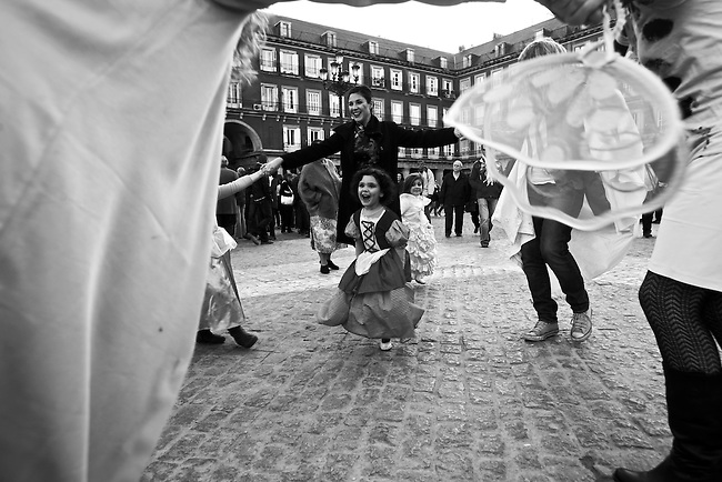Women and children dance in La Plaza Mayor in Madrid, Spain. Feb. 22, 2009.