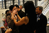Burbank, CA - August 5, 2009 -- (L-R) Journalist Laura Ling cries as she talks with sister/journalist Lisa Ling after arriving at Hangar 25 on August 5, 2009 in Burbank, California after being released by North Korean authorities yesterday. Laura Ling and Euna Lee, of San Francisco based Current TV, were both arrested by North Korea in March for illegally entering the country on the Chinese border. Yesterday they were pardoned by President Kim Jong-Il after a meeting with former U.S. President Bill Clinton. Ling and Lee had been sentenced to 12 years in prison in June.  .Credit: Kevork Djansezian - Getty Images for Shangri-La from CNP