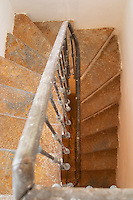 A winding staircase. Chateau de Lascaux, Vacquieres village. Pic St Loup. Languedoc. France. Europe.