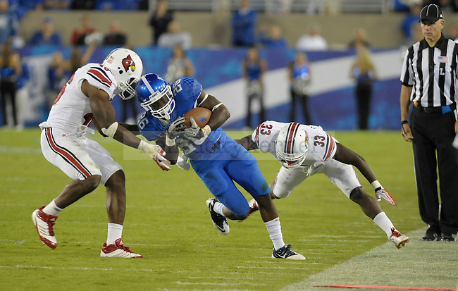 CoShik Williams runs the ball during the second half of the University of Kentucky football game against Louisville at Commonwealth Stadium in Lexington, Ky., on 9/17/11. UK lost the game 17-24. Photo by Mike Weaver | Staff