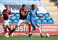 Jevani Brown of Colchester United lays off under pressure from Joe Bunney of Northampton Town during Colchester United vs Northampton Town, Sky Bet EFL League 2 Football at the JobServe Community Stadium on 24th August 2019