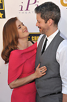 Amy Adams &amp; Darren Le Gallo at the 19th Annual Critics' Choice Awards at The Barker Hangar, Santa Monica Airport.<br /> January 16, 2014  Santa Monica, CA<br /> Picture: Paul Smith / Featureflash