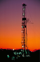 Petroleum Industry; oil; drilling rig; production; domestic; dusk; twilight. Houston Texas.