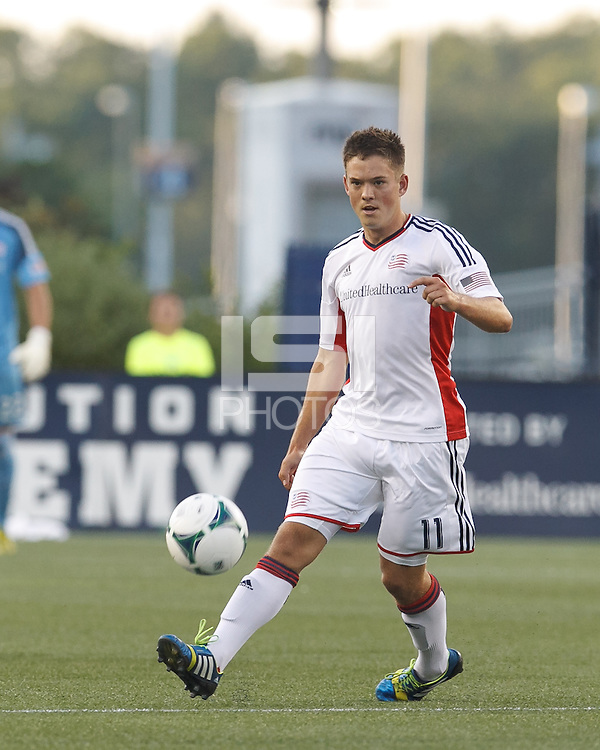 New England Revolution midfielder Kelyn Rowe (11) passes the ball.  In a Major League Soccer (MLS) match, the New England Revolution (white) defeated San Jose Earthquakes (black), 2-0, at Gillette Stadium on July 6, 2013.