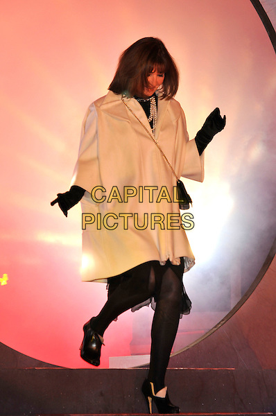 STEPHANIE BEACHAM.Contestants enter the House on the Opening Night of Celebrity Big Brother, Elstree Studios, London, England..January 3rd, 2010.CBB BB full length white coat black gloves cream tights ankle boots booties bag cross body chain strap hands looking down .CAP/PL.©Phil Loftus/Capital Pictures.
