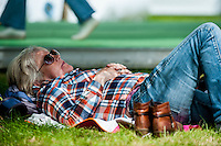Tuesday 31 May 2016. Hay on Wye, UK<br /> Pictured: A woman relaxes and reads in the sun <br /> Re: The 2016 Hay festival take place at Hay on Wye, Powys, Wales