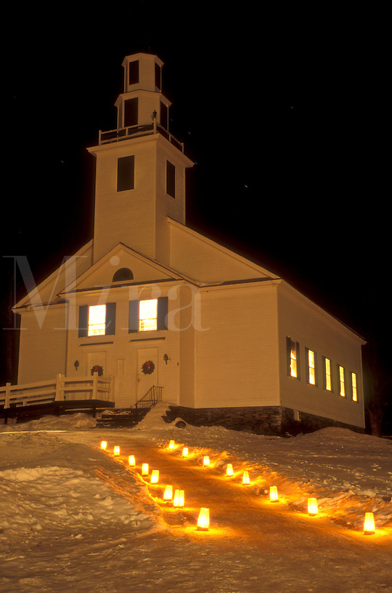 AJ5866, church, chapel, candles, decorations, outdoor, holiday, Christmas, snow, winter, The path to the Old Meeting House is lit with candles for Christmas Eve service in East Montpelier Center on a snow covered night in Washington County in the state of Vermont.