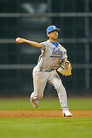 Third baseman Tyler Rahmatulla #5 of the UCLA Bruins makes a throw to first base versus the Rice Owls in the 2009 Houston College Classic at Minute Maid Park February 27, 2009 in Houston, TX.  The Owls defeated the Bruins 5-4 in 10 innings. (Photo by Brian Westerholt / Four Seam Images)