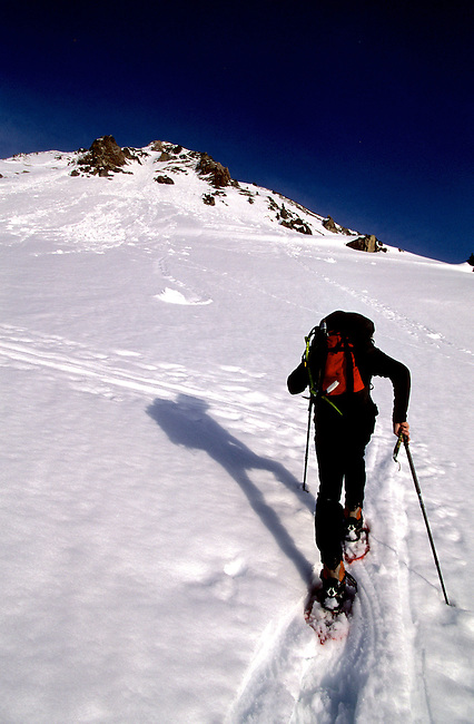 Snowshoeing man, Bastan pass, Hautes-Pyrenees, France.