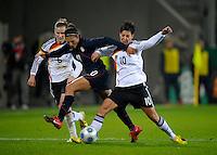 Carli Lloyd (10) battles between Simone Laudehr and Linda Bresonik. US Women's National Team defeated Germany 1-0 at Impuls Arena in Augsburg, Germany on October 29, 2009.