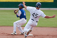 30 july 2010: Felix Brown of Team France throws the ball to the first base for the double play during Italy 9-2 win over France, in day 6 of the 2010 European Championship Seniors, at TV Cannstatt ballpark, in Stuttgart, Germany.
