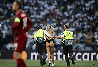 A woman is taken away by security after invading the pitch during the UEFA Champions League final football match between Tottenham Hotspur and Liverpool at Madrid's Wanda Metropolitano Stadium, Spain, June 1, 2019.<br /> UPDATE IMAGES PRESS/Isabella Bonotto