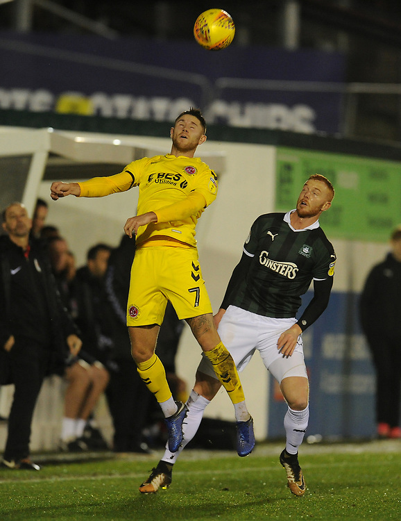 Fleetwood Town's Wes Burns under pressure from Plymouth Argyle's Ryan Taylor<br /> <br /> Photographer Kevin Barnes/CameraSport<br /> <br /> The EFL Sky Bet League One - Plymouth Argyle v Fleetwood Town - Saturday 24th November 2018 - Home Park - Plymouth<br /> <br /> World Copyright © 2018 CameraSport. All rights reserved. 43 Linden Ave. Countesthorpe. Leicester. England. LE8 5PG - Tel: +44 (0) 116 277 4147 - admin@camerasport.com - www.camerasport.com