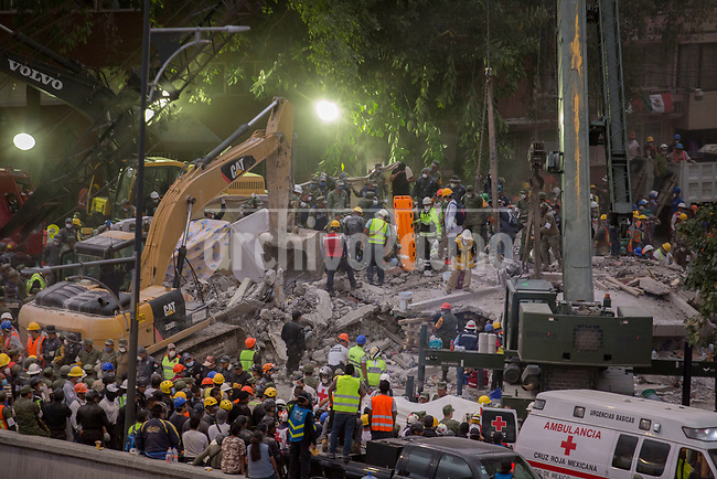 Rescue volunteers remove debris and try to find survivors after a building collapsed near   Delegacion Benito  Juarez after  a 7.1 earthquake in Mexico capital city