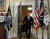 Washington, D.C. - March 19, 2007 -- United States President George W. Bush arrives to make a statement marking the fourth anniversary of the start of the war in Iraq from the Roosevelt Room of the White House on Monday, March 19, 2007. <br /> Credit: Roger L. Wollenberg - Pool via CNP