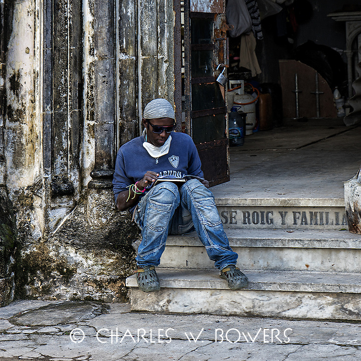 Faces Of Cuba - Worker makes plan for the day.<br />