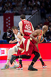 Real Madrid's player Luka Doncic and Estrasburgo's players Dupport and Collins during Euroligue Basketball at Barclaycard Center in Madrid, December 17, 2015<br /> (ALTERPHOTOS/BorjaB.Hojas)
