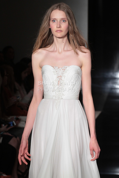 Model walks runway in a silk chiffon hand draped gown with re-embroidered lace applique, from the Reem Acra Spring 2017 bridal collection, during New York Bridal Fashion Week Spring Summer 2017, on April 15, 2016.
