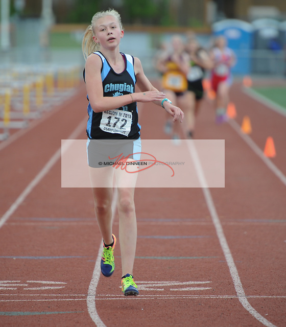 Chugiak's Emma Sees wins the 3200  meter run with a time of 11:42.12 at the Region IV Track and Field Championships.  Photo by Michael Dinneen for the Star