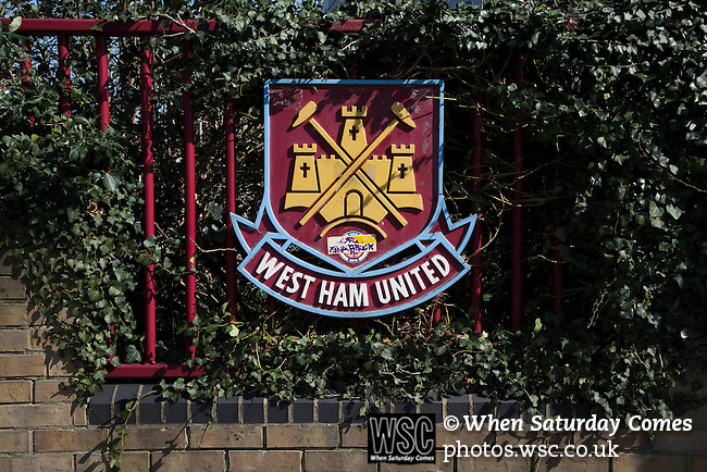 West Ham United 2 Crystal Palace 2, 02/04/2016. Boleyn Ground, Premier League. A club crest on railings at the entrance to the Boleyn Ground, pictured before West Ham United hosted Crystal Palace in a Barclays Premier League match. The Boleyn Ground at Upton Park was the club's home ground from 1904 until the end of the 2015-16 season when they moved into the Olympic Stadium, built for the 2012 London games, at nearby Stratford. The match ended in a 2-2 draw, watched by a near-capacity crowd of 34,857. Photo by Colin McPherson.