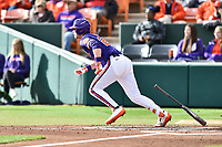 Clemson Tigers left fielder Seth Beer (28) runs to first base during a game against the Notre Dame Fighting Irish at Doug Kingsmore Stadium on March 11, 2017 in Clemson, South Carolina. The Tigers defeated the Fighting Irish 6-5. (Tony Farlow/Four Seam Images)