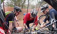 NWA Democrat-Gazette/FLIP PUTTHOFF <br /> Tim Scott, assistant superintendent at Devil's Den State Park (center) repairs a broken chain for a rider April 1, 2016 on a group ride during the Ozark Mountain Bike Festival.