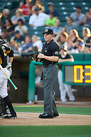 Home plate umpire Junior Valentine handles the calls during the game between the Salt Lake Bees and the New Orleans Baby Cakes at Smith's Ballpark on June 8, 2018 in Salt Lake City, Utah. Salt Lake defeated New Orleans 4-0.  (Stephen Smith/Four Seam Images)