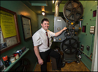 BNPS.co.uk (01202 558833)<br /> Pic: PhilYeomans/BNPS<br /> <br /> Andy with the huge projector.<br /> <br /> Field of Dreams....<br /> <br /> Film buff Andy Jones has built an ABC cinema in his back garden as a lasting tribute to the now defunct movie company.<br /> <br /> Andy, 38, has taken four and a half years and spent &pound;70,000 of his life savings building the 34-seat cinema from scratch.<br /> <br /> The father-of-two's movie house mirrors cinemas of the 1930s with big red curtains, red seats and a parquet floor in the projection room. <br /> <br /> The brick building, which is adorned with an ABC sign, is 40ft tall, 22ft wide and 20ft high and takes up half of the garden of his three bed semi-detached house.<br /> <br /> The theatre, which has a 17ft by 7ft screen, has its own projection room, black and white old-style toilets and a foyer with a concessions stand that offers popcorn and sweets.