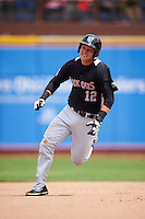 New Britain Rock Cats third baseman Pat Valaika (12) running the bases during a game against the Akron RubberDucks on May 21, 2015 at Canal Park in Akron, Ohio.  Akron defeated New Britain 4-2.  (Mike Janes/Four Seam Images)