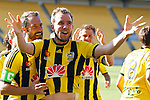 Phoenix's Jeremy Brockie, centre, celebrates after scoring against the Brisbane Roar in the A-League football match at Westpac Stadium, Wellington, New Zealand, Sunday, January 04, 2015. Credit: Dean Pemberton