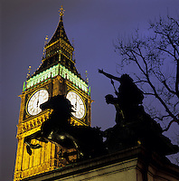 United Kingdom, England, London: Nightshot of Big Ben with statue of Boudicca