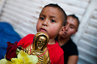 A Mexican devotee holds a figurine of Santa Muerte (Saint Death) outside the shrine in Tepito, a rough district of Mexico City, Mexico, 1 May 2011. The religious cult of Santa Muerte is a syncretic fusion of Aztec death worship rituals and Catholic beliefs. Born in lower-class neighborhoods of Mexico City, it has always been closely associated with crime. In the past decades, original Santa Muerte's followers (such as prostitutes, pickpockets and street drug traffickers) have merged with thousands of ordinary Mexican Catholics. The Saint Death veneration, offering a spiritual way out of hardship in the modern society, has rapidly expanded. Although the Catholic Church considers the Santa Muerte's followers as devil worshippers, on the first day of every month, crowds of believers in Saint Death fill the streets of Tepito. Holding skeletal figurines of Holy Death clothed in a long robe, they pray for power healing, protection and favors and make petitions to 'La Santísima Muerte', who reputedly can make life-saving miracles.