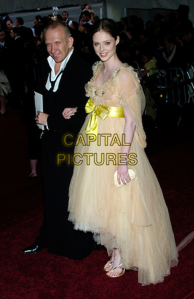 "JEAN-PAUL GAULTIER & COCO ROCHA.2007 Metropolitan Museum of Art Costume Institute Gala celebrating ""Poiret: King of Fashion"" exibition at the Metropolitan Museum of Art, New York City, New York, USA..May 7th, 2007.full length black suit chiffon sheer gown prom dress ribbon bow gold shoes.CAP/ADM/BL.©Bill Lyons/AdMedia/Capital Pictures *** Local Caption ***"