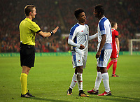 (L-R) Referee Bart Vertenten speaks to Luis Ovalle of Panama during the international friendly soccer match between Wales and Panama at Cardiff City Stadium, Cardiff, Wales, UK. Tuesday 14 November 2017.